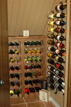 Under the stairs wine closet.  who needs a place for coats?  THIS is a much better idea for my closet.