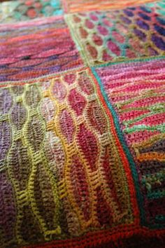 Chameleon baby blanket.  Wow!  I loved the knitted version of this blanket but knew I'd never have the patience to knit it.  I could have patience for the crochet verstion though!