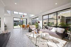 #livingroom #concreteflooring #newhome #contemporaryliving #burntorange #highceiling #fisthome #openplan #openliving #yourhome #openspace #windows #displayhome