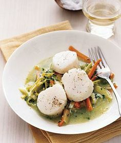 Poached Scallops With Leeks and Carrots recipe from realsimple.com #myplate #protein #vegetables