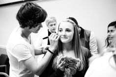 4:52PM: Harry Styles signs a fan's face backstage at the mall.