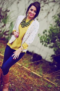 Polka dot cardigan, yellow top, green and brown accents