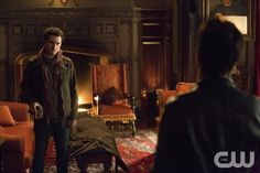 """The Vampire Diaries -- """"The Devil Inside"""" -- Image Number: VD512a_0214.jpg -- Pictured (L-R): Michael Malarkey as Enzo and Ian Somerhalder as Damon (back to camera) -- Photo: Bob Mahoney/The CW -- © 2013 The CW Network, LLC. All rights reserved."""