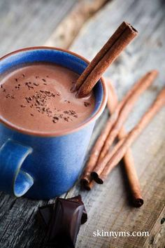 hot chocolate made with almond milk, dark chocolate chips, honey, vanilla, and a cinnamon stick