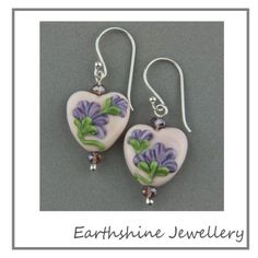Wk 34/52  I made this weeks pair of earrings with a pair of my own floral lampwork hearts, teamed together with some crystals and sterling silver components.