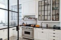 Love the upper cabinets and kitchen floor.  So cool!