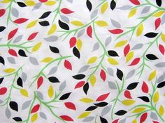 We LOVE this lightweight cotton lawn print fabric with stylized leaves for looking how while staying cool this summer! From VogueFabricsStore.com.