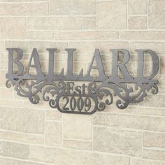 """Kinship Pewter Family Name and Year Personalized Metal Wall Art Sign $130 36""""Wx1.5""""Dx13.5""""H Name of my house :)"""