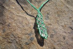 Green waxed cord macrame necklace with a unique quartz stone pendant. Quartz is a healing stone and known to send away negative energy.  This necklace can be tied around the back and is therefore adjustable to the length of your preference. It has been made for best fit to sit close