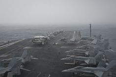 INDIAN OCEAN (June 9, 2013) The aircraft carrier USS Nimitz (CVN 68) transits through inclement weather. Nimitz Strike Group is deployed to the U.S. 5th Fleet area of responsibility conducting maritime security operations and theater security cooperation efforts. (U.S. Navy photo by Mass Communication Specialist 3rd Class Raul Moreno Jr./Released)