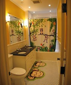 Playful and vivid jungle theme surely lights up this bathroom design with glee