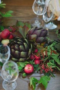 If you have a deeper color palette, you can still play up your rich colors with fruits and veggies like eggplants, artichokes, apples, pomegranates, and dark berries. #weddingplanning #weddingdecor #weddingideas #atlantaweddings