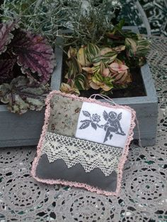 Very sweet in grey and white with cream lace and the lovely hand crocheted lace on the outside.
