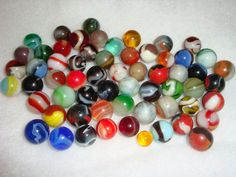 Antique Glass Marbles - 61 total in this group. $295.00, via Etsy.
