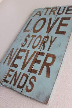 "One of the many ""A true love story never ends"" signs available"