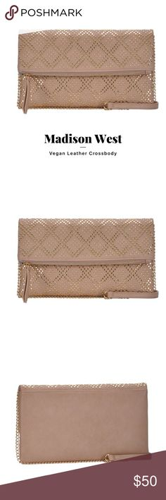 Madison West Crossbody Taupe peta approved vegan leather with gold chain and front stud detail. The detachable chain is perfect for nights out to use as an elegant clutch. Inside details include an open easy accessible magnetic closure pocket for easy access and to your phone or keys, Dimensions: 11.5 x 6.75 x 1 Madison West Bags Crossbody Bags