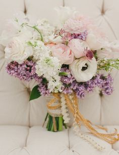 pink and purple bouquet with gold wrapped ribbons