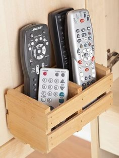 Remote Caddy: A little wooden box mounted to the back of an entertainment center door provides a perch for multiple remotes.