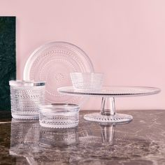 The groundbreaking raised droplet design of Kastehelmi came from legendary designer Oiva Toikka's goal to find a way to hide joint marks in glass. String Of Pearls, Natural Lip Balm, Bowl Designs, Womens Size Chart, Pressed Glass, Settee, Acacia Wood, Teller, Home Decor Accessories