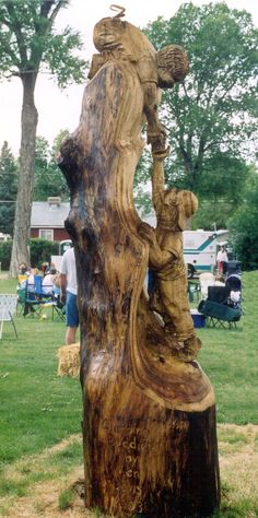 Boy's at play carving