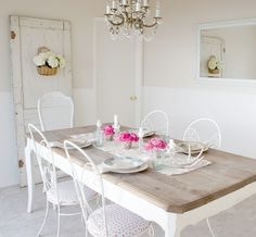 Pretty table, old door w/ chippy paint, crystal chandelier.