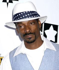 Snoop Dog wearing a great summer hat in white with printed band.