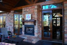 I want those doors, that stone, and the fireplace!!