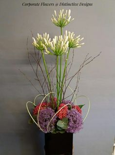 White agapanthus with celosia crisis and alliums recessed for this reception desk corporate flower display San Francisco Florist, White Agapanthus, Corporate Flowers, Sympathy Flowers, Flower Studio, Mothers Day Flowers, Flowers Delivered, Garden Theme, Floral Designs
