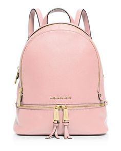 This Michael Michael Kors backpack is a street-wise stunner in sumptuous leather and zip hardware. Thanks to its scaled-down silhouette, it's sleek enough to tote from your morning commute to after-ho