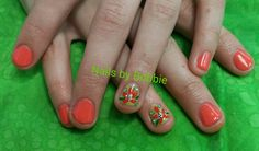 Coral and gold Shellac with flowers on my 10 year old daughter. Great way to stop the nail biting