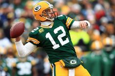 Aaron Rodgers and his Green Bay Packers get shocked in over-time by the Seattle Seahawks