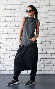Urban style casual black maxi pants - METP0026 Super cool street wear maxi pants that are very comfortable to wear and suit numerous tops and tunics. The style is oversize and loose which gives you comfort and flexibility. The pants have a front accent as well as two side pockets. Wear them with some sneakers for a complete look!  This piece is made of 100% cotton. WHEN YOU PLACE AN ORDER YOU MUST LEAVE A TELEPHONE NUMBER AND CORRECT COORDINATES! WE DO NOT TAKE RESPONSIBILITY FOR MISSING…