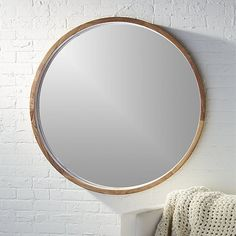 """Free Shipping.  Shop acacia wood 40"""" mirror.   Solid sustainable acacia wood comes full circle to showcase a sweeping grain and warm hi/lo tones.  Spanning over three feet in diameter, handcrafted wooden frame rings the inset mirror with 3D depth."""