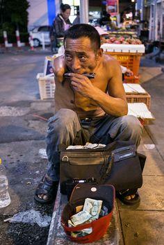One armed street performer . Bangkok