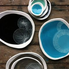 So who decided that plates HAVE to be round? I like these dishes; they feel like happenstance. Kim Wallace Ceramics