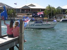 Mandurah Australia Day celebrations start with a big Aussie Breakfast on Mandurah Foreshore and finish with a boat Flotilla through the canals and estuary, seen here from our jetty at Port Sails Canal Villa