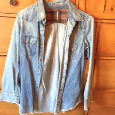 A flannel that is a jean jacket material Jean jacket material in flannel form. You can either wear something under the shirt or button it up with the snap button type. Free People Tops Button Down Shirts
