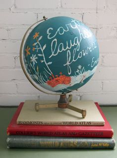 Earth Laughs In Flowers/ Hand Painted Vintage Globe by amyriceart   Where in the world will you laugh on Global Belly Laugh Day, January 24?  On Jan. 24 at 1:24 p.m. (local time) smile, throw your arms in the air and laugh out loud. Join teh Belly Laugh Bounce Around the World.
