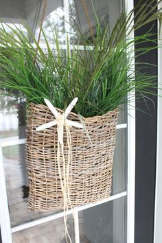 For front door. Cute starfish hanging on a basket with sea grass!.