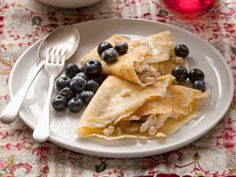 Banana, ricotta and white chocolate crepes    Nothing says 'Happy Mother's Day' more than breakfast in bed. These crepes are easy to make and we promise your mum will love them!