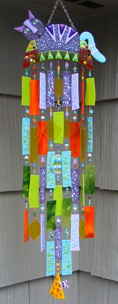 Stained and fused glass wind chimes, suncatchers, fan pulls, wall and window decorations crafted by Jeanne Van Kirk.