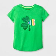 Your little chick will be taking on her St. Patrick's Day in style with this Green Short-Sleeve St. Patrick's Day Multi Shamrock Graphic T-Shirt from Cat & Jack™. This green tee features a shamrock graphic across the front in green sparkles and colorful stripes. Pairing perfectly with any of her favorite bottoms, she'll love wearing this long after the holiday is over.