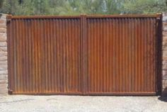 Affordable Fence and Gates build the best looking, safest corrugated steel fence…period! We offer it installed both horizontally and vertically. Any height is available. In a natural rust finish …