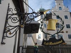 This is an old unique artistic shop sign for a restaurant called 'Schalander'. It is located at pedestrian area in the 'Fischersteige 9' in Kempten, Germany, Bayern.