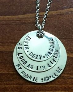"""As Long As I'm Living Name Necklace """"As long as I'm living"""" necklace personalized for a mother or grandmother- customize with baby, mommy, Grandma daughter mimi or nonnie. Sweet words inspired by the children's book, Love You Forever.    Sterling silver, hand stamped necklace.  Layered circle charms measure 1 1/4″.  Top charm is optional- personalize with name of children or grandchildren.  Middle charm- """"As long as I'm living"""""""