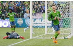 Seattle Sounders' Kenny Cooper, right, reacts after his shot on goal went just wide of the post in the second half of an MLS soccer match against Sporting Kansas City, Saturday, March 8, 2014, in Seattle. The Sounders beat Sporting KC 1-0.