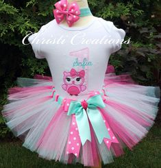 Baby Girl 1st Birthday Tutu Whoos One! This adorable baby girl first birthday tutu will have her looking pretty as a picture! Just watch her face light up when you dress her up on her special birthday. Created in aqua and pink colors with the cutest owl! Personalized with the