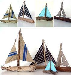 barcos realizados con madera de deriva y telas recicladas