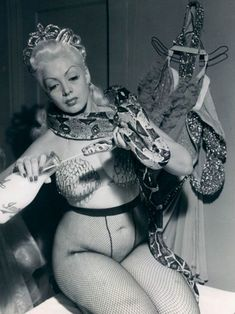 Burlesque dancer Zorita feeding her snake..