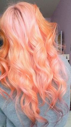 Orange and pink hair. It reminds me of sherbet ice cream.